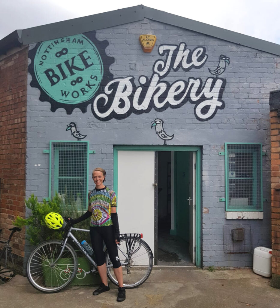 Clare stood with her bike in front of Bikeworks