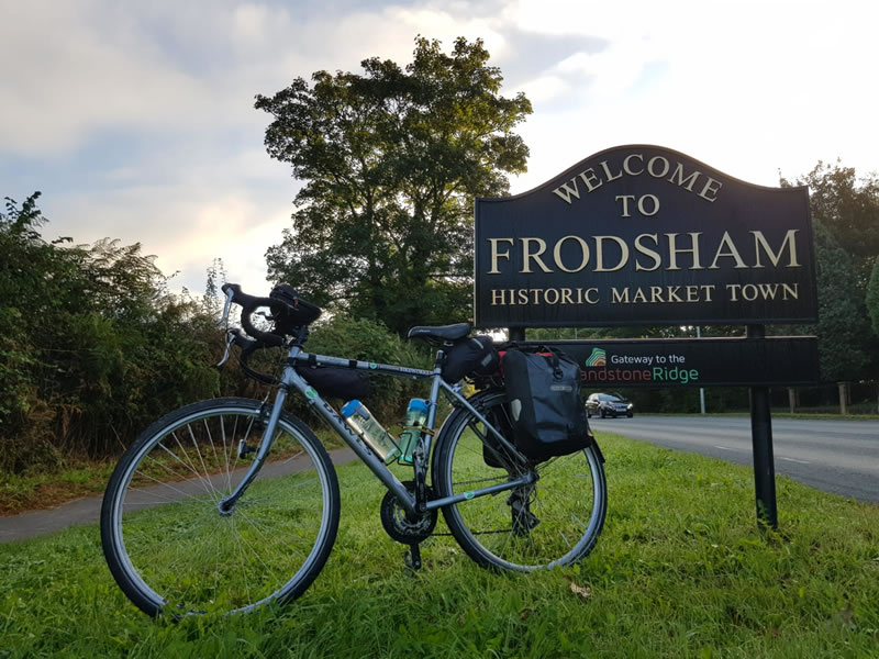 Bike in front of Frodsham sign