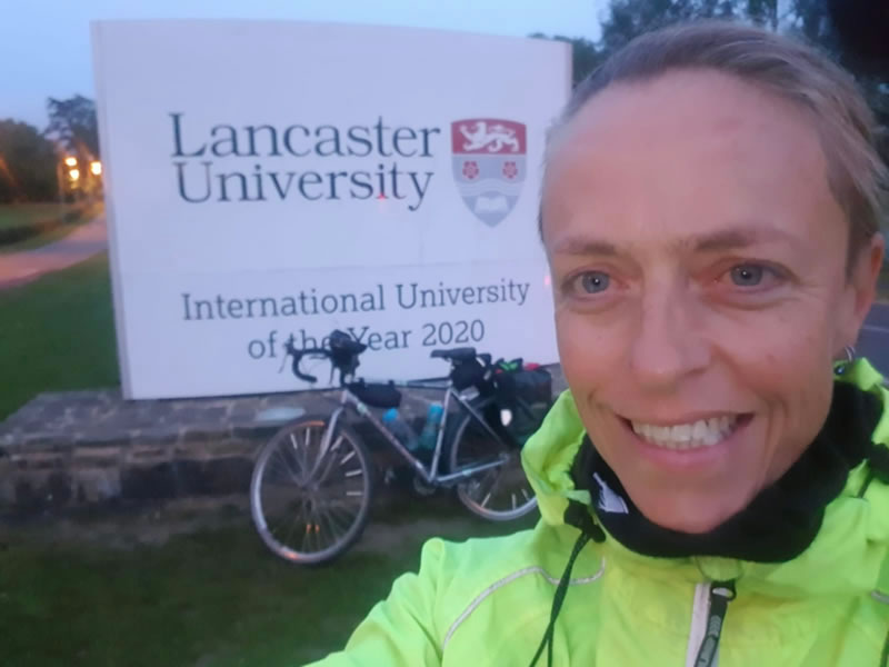 Clare in front of a Lancaster uni sign