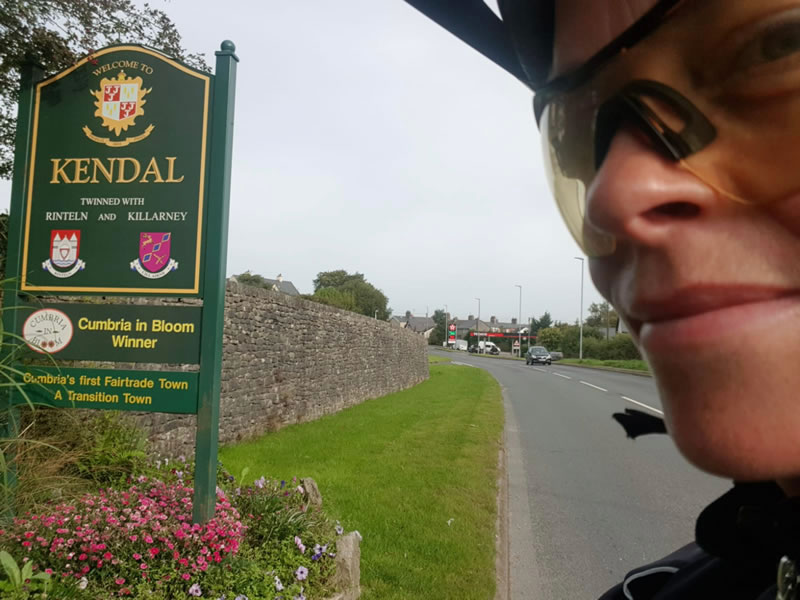 Clare in front of a welcome to Kendall sign