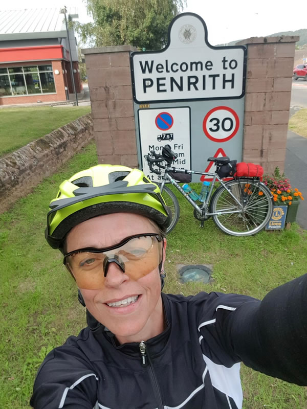 Clare in front of a Penrith sign