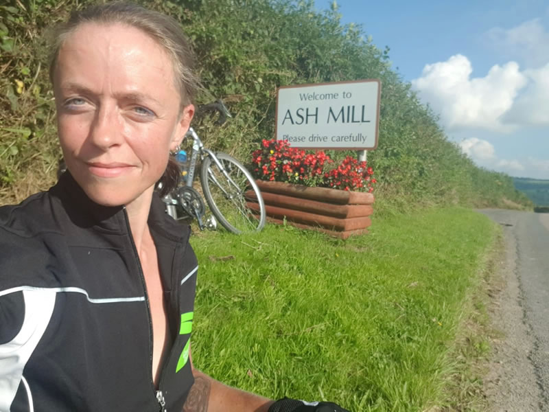 Clare in front of an Ash Mill sign